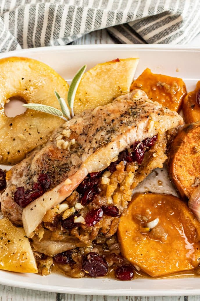 Stuffed pork chops with cranberry stuffing and served with roasted sweet potatoes, yams, and onion.