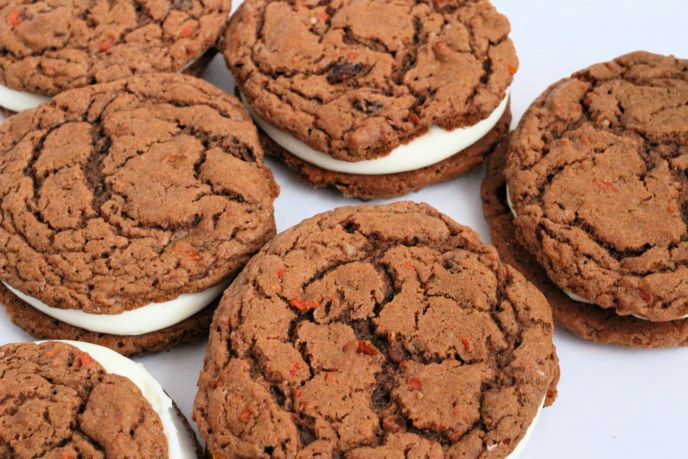 Carrot cake cookies on a white parchment baking sheet