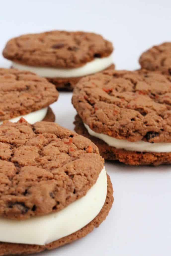 Carrot cake cookie sandwich whoopie pies, cream cheese frosting sandwiched between two carrot cake cookies.