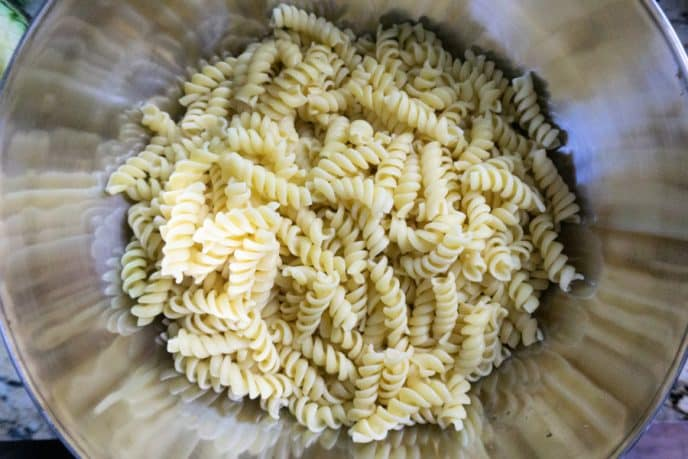 Rotini for a cold pasta salad recipe in a bowl ready for other ingredients to be mixed in.