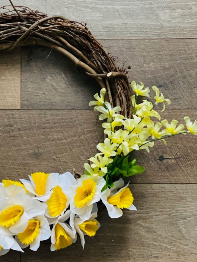 DIY Flower wreath with grapevine and daffodils.