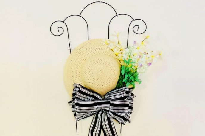 Sun hat homemade trellis wall decor with faux flowers.