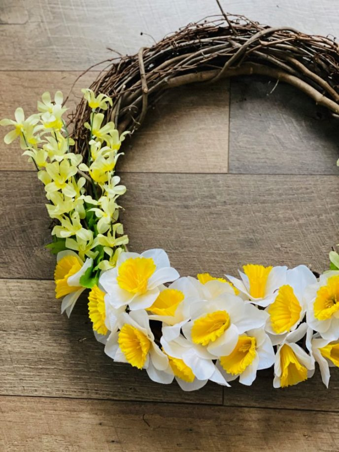 Flower wreath DIY tutorial with daffodils, dripping blossoms, and grapevine.