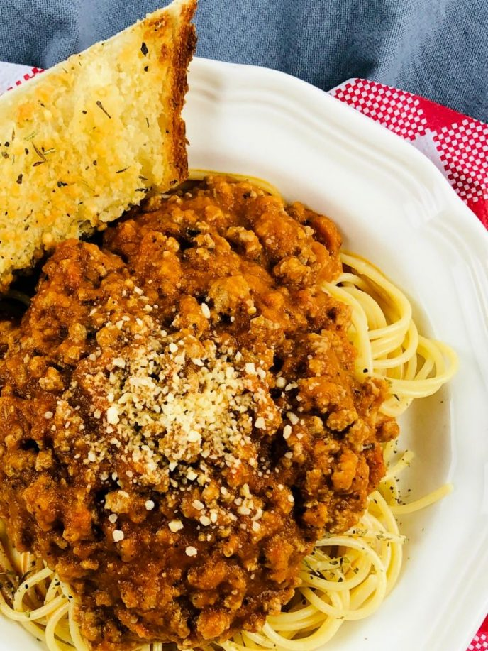 Homemade spaghetti sauce with meat served of spaghetti noodles.