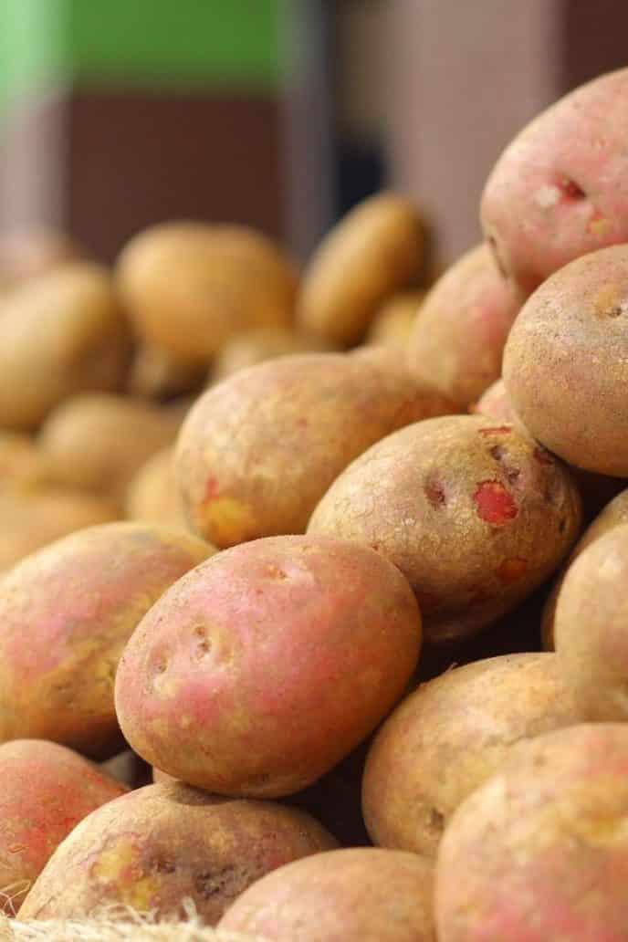 Raw potato cut in half to remove rust