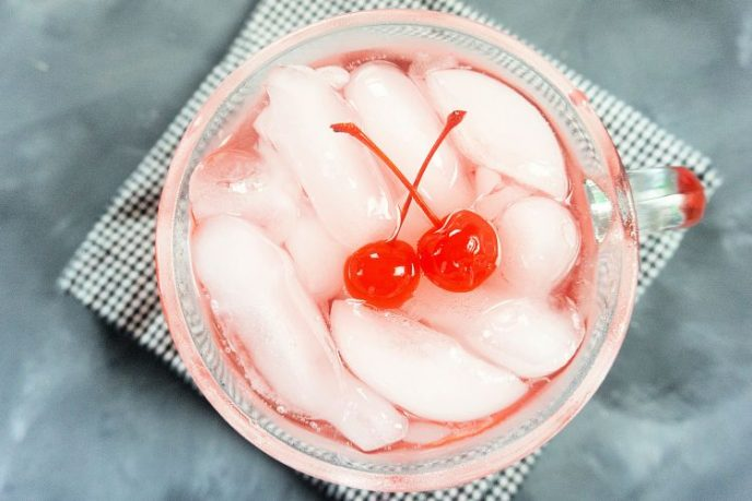 Type of glass for Shirley Temple, in a glass cup top down view of drink.