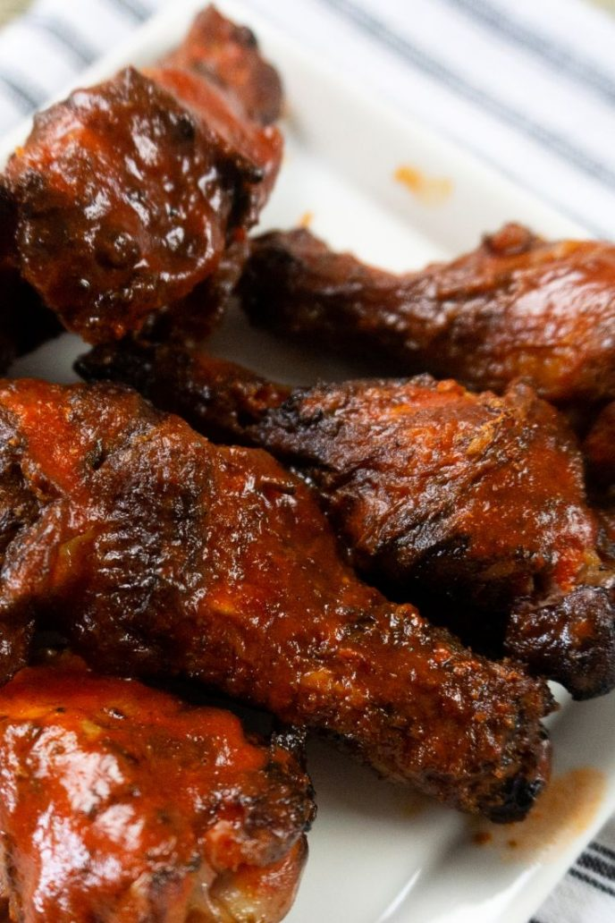Smoked wings, these smoked chicken wings have BBQ sauce on them.