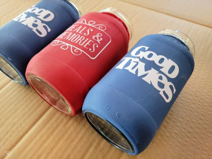 White cricut design that says Good Times on red and blue mason jars