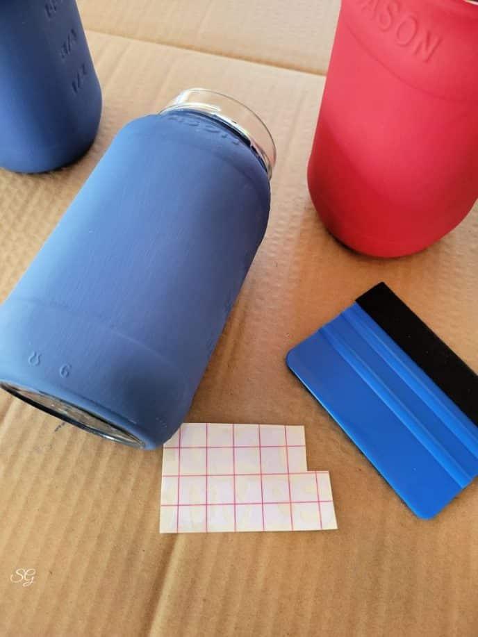 Applying vinyl cricut design to painted mason jars